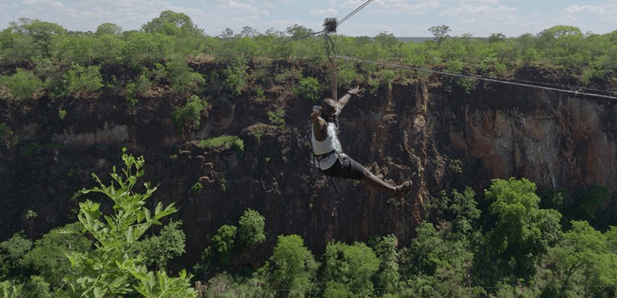 Striking a pose whilst dangling precariously between two towering gorges in livingstone, zambia, i bet its not only us who would be feeling giddy in the heat of such a moment