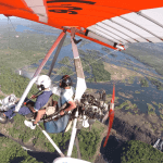 Soaring over the victoria falls, africa's largest falls, in a hang glider with a motorised engine and seating area. The ultimate experience if you ask us
